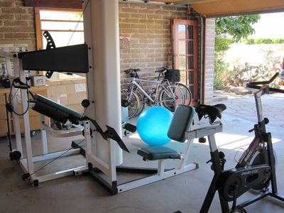 Garage converted to a gym with spin bike, weight set and more...views of Toro Pk