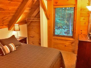 Killington house photo - Right: The upstairs left bedroom has a queen bed and sleeps two.