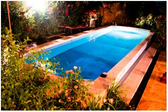 Swimming at night under the moonlight in our refreshing, clean pool