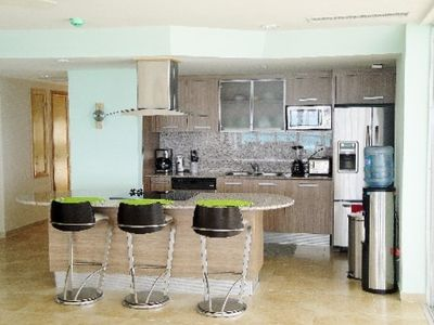 Modern Kitchen with: Refrigerator, Stove, Oven, Bar, Dishwasher, etc.