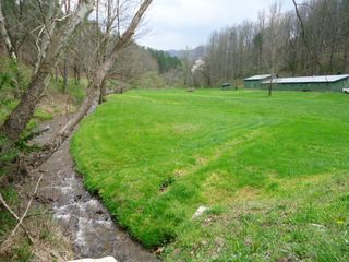 Bryson City cabin photo - This is the horse farm and sawmill creek that sets below the cabin.