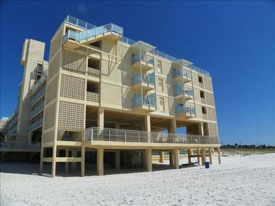 Building view from beach (shows balcony units and sun/grill decks)
