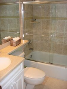 All New Guest Bathroom with Corian Counter Top and Tub/Glass Doors