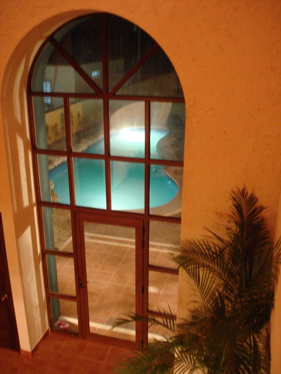 View of Entry and Pool taken from 2nd Floor Balcony