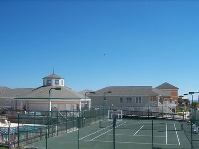 Tennis court, pools and Club House