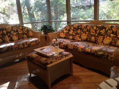 Relaxing screened porch with sofa, loveseat and chair