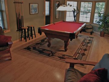 Downstairs game room with pool table and TV