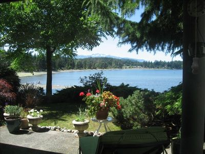 view of patio and of Craig Bay from the kitchen window
