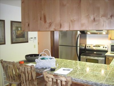 Fully equipped gourmet kitchen with high-end appliances.