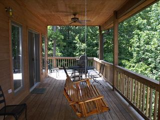 Lake Ouachita condo photo - Deck with porch swing, table and chairs, charcoal