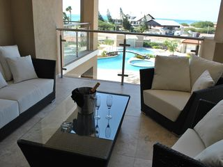 Aruba condo photo - Amazing View from Balcony of Oasis Pool Area and Eagle Beach across the street !