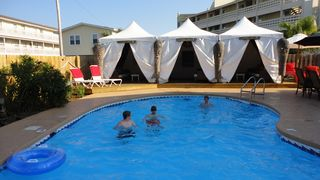 Gulf Shores bungalow photo - Tiki Pool complete with your private Cabana with 32' plasma,Wii,Cable and DVD!!!