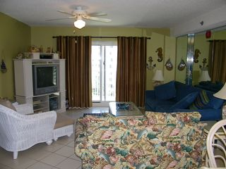 Orange Beach condo photo - Living room, queen sofa bed, tv/dvd player, balcony entrance