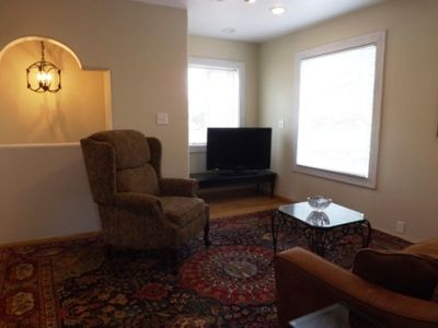 Living room with flatscreen HD TV. Cable TV service included.