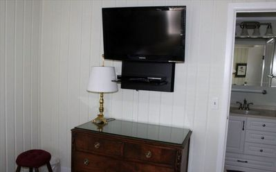 "Wall mounted 32"" flat screen TV and Blue Ray DVD in bedroom."