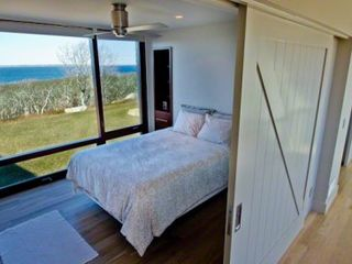 Chilmark house photo - Bedroom #3 - Queen Bed. Sliding Barn Door, Floor-To-Ceiling Windows, Water Views, Mahogany Built-ins