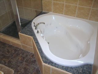Galveston house photo - Oversize jacuzzi tub soothes the body