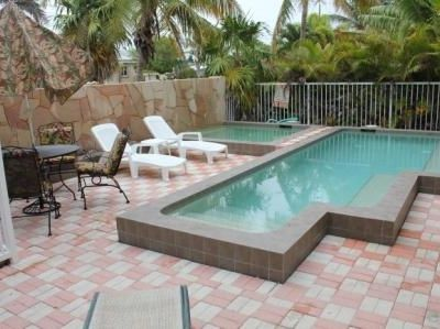 Relax in your private spa retreat with 2 pools and a fountain wall.