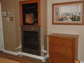 Gas fire place , and TV to be enjoyed in the spacious bedroom