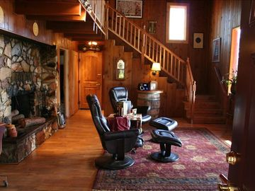 Pioneer cabin rental - LIVING ROOM faces onto front deck with great views, complete privacy and peace.