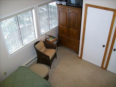 Guest Bedroom with armoire and closet offer plenty space for you to unpack.