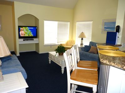 Large Livingroom - 2 sofas and large flat-screen TV. Open to dining and kitchen