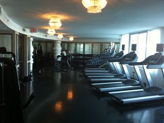 Fitness room with water view