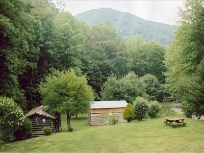 Summer view of the barns in the meadow from Joey's Creekside Cabin