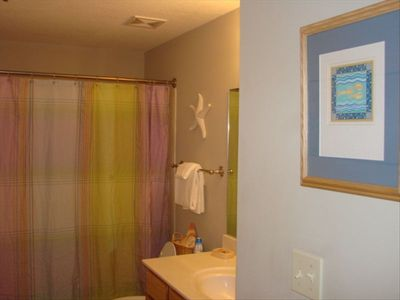 Guest bathroom is accessible from hall or guest bedroom