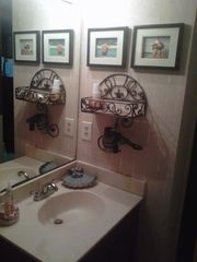 Bathroom area with blow dryer and shelf for your toiletries - Corpus Christi condo vacation rental photo