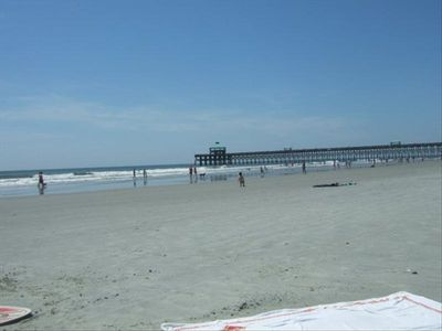 Fishing pier with restaurants and miles and miles of sandy white beach.