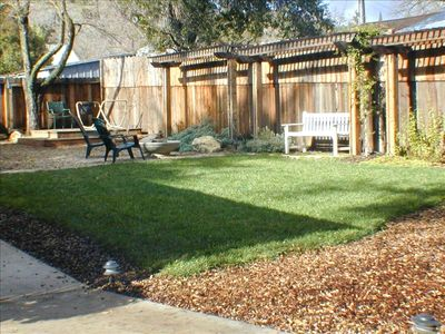 Quiet backyard with a private hot tub, hammock and fire pit for your enjoyment.