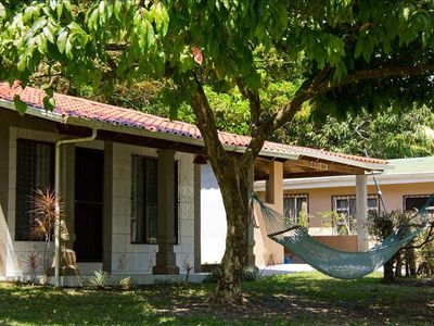Front of the house with hammock and view of the 'rancho'.