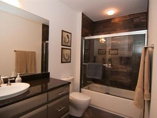 Cocoa Beach condo photo - Guest bathroom with stone wall tile in shower & large linen closet in hallway.