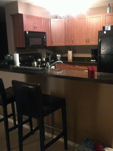 roomy kitchen with sitting counter