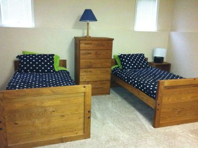 twin beds in lower level area