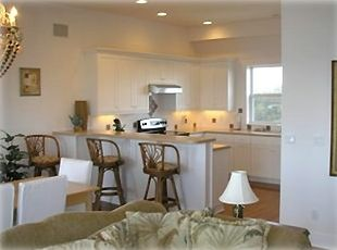 Upstairs Gourmet Kitchen, Beautiful Dining Room & Cushy Living Room