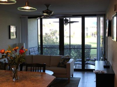Large sliding glass doors which lead out onto the screened patio