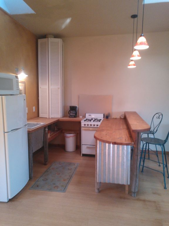 Kitchen, gas stove and on demand hot water.