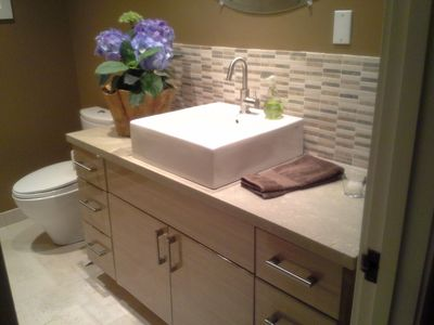 Bathroom 2 --- recently remodeled with a new tub / shower and heated floor.