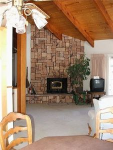 "Fireplace and ""open"" living room provides for dreamy days, and cozy nights!"