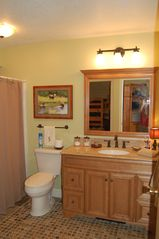 Lincoln townhome photo - Guest bathroom with granite and stone tile, and 1 switch kick board floor heater