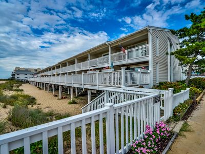 spacious, traditional 3 bedroom oceanfront townhouse with wiFi, a large covered deck, balcony access from multiple rooms, and amazing view of ocean located uptown in family-friendly neighborhood and mere steps to beach!