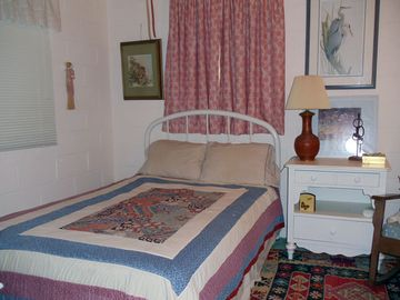 Second bedroom has two double iron beds.