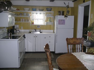 Kitchen stocked w/Cookware & Dinnerware