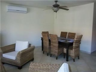 Aruba condo photo - Living room w ceiling fan & flat screen TV