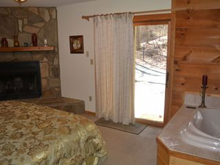 Gatlinburg chalet photo - Master suite opens to the driveway for easy loading and unloading.