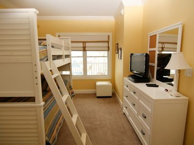 3rd bedroom with full sized bunk bed with trundle under; HD TV on dresser