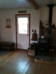 Wood stove & door to deck.