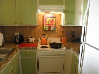 Kitchen with Bose speaker, coffee maker, electric wine opener and orignal art.